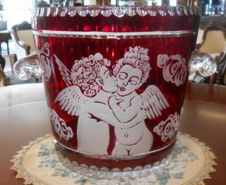 "European Cut & Etched Ruby Red Crystal Champagne Bucket Beautiful Cut and Etched Ruby European Crystal Champagne or Ice Bucket. Deep wheel cut and Beautiful Cherubs or Putti etched into Heavy lead crystal. Stands 10-1/2"" tall. Condition is Mint. No Damage. Serious inquires Please contact us. Click on Picture to see Price and additional photos of this item."