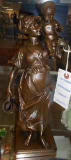 "Antique Bronze Figure by Edmond Louis Charles Tassel Investment Quality Antique Bronze Figure by Edmond Louis Charles Tassel (French, active 1870-1900). A Woman and Child. She stands 15"" tall. Signed ""E. Tassel"" with Foundry mark as well as  ""Giraud"".  Serious inquires Please contact us. Click on Picture to see additional photos."