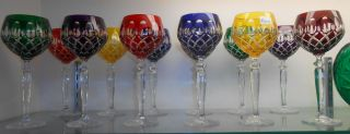 Set of 12 Multi-color Cut Crystal Wine Glasses  Set of 12 Multi-color Cut Crystal Wine Glasses. Mint Condition. No damage. Serious inquires Please contact us. Click on Picture to see additional photos.