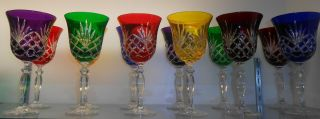 SET OF 12 MULTI COLOR EUROPEAN CUT CRYSTAL WINE GLASSES Set of 12 Multi Color European Cut Crystal Wine Glasses. Mint Condition. No damage. Serious inquires Please contact us. Click on Picture to see additional photos.