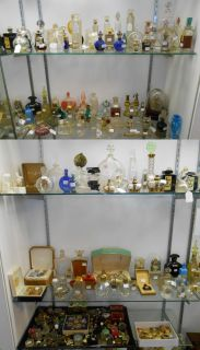 "Huge Perfume Bottle Collection Recently acquired. A Huge & Awesome Perfume Bottle Collection. Well over 1000 bottles. Several Signed ""R. Lalique"". Too many to mention. Serious inquires Please contact us. Click on Picture to see additional photos."