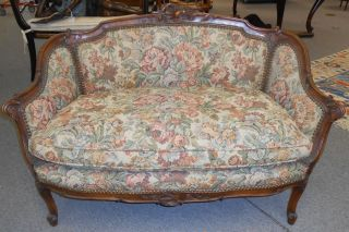 "Antique French Upholstered Settee Beautiful petite Antique French Settee. Great carving. Beautiful Tapestry upholstery. Measures aprox 50"" wide x 32-1/2"" tall x 26"" deep. Great condition.  Serious inquires Please contact us. Click on Picture to see additional photos."