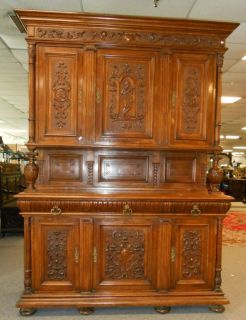 "Italian Renaissance Style Carved Walnut Sideboard Beautiful and Monumental Italian Renaissance Style Carved Walnut Sideboard. Circa 1880's. High Quality carving. Original Finish. Loads of storage. Stands 97"" tall x 70"" wide x 24"" deep. Very high quality. Condition is very good with minor surface scratches from age. No damage. Breaks down for moving. Starting bid $50. Auction Estimate $500 - $600."