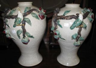 """Pair of Celedon Art Pottery Vases with Birds Gillian Bliss Beautiful Pair (2) of Art Pottery Vases with applied Birds on Branches by British Artist Gillian Bliss. Signed. Celedon style Glaze. Each measures 16"""" tall. Condition is excellent. No damage. Starting bid $50 for both. Auction Estimate $80 - $120."""