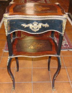 """Antique French Bronze Mounted Marquetry Sewing Side Table  Antique French Bronze Mounted Marquetry Sewing Side Table. Two Tiered. Measures 31"""" tall x 15-1'2"""" wide x 11-1/2"""" deep. Overall condition is good with minor wear typical from age. Starting Bid $50. Auction Estimate $350 - $400."""