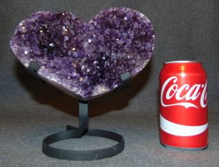 "Large Heart Shaped Amethyst Crystal Geode on Iron Stand Large Heart Shaped Amethyst Crystal Geode on Wrought Iron Stand. Measures 8"" tall x 7-1/2"" wide. Condition is very good. New condition. No Damage. Starting Bid $50. Auction Estimate $80 - $120."