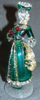 "Vintage Murano Art Glass Woman Figure Vintage Murano Art Glass Woman Figure. Clear and Green with Gold Leaf as well as Red Roses. Measures 8-3/4"" tall. Condition is very good with minimal wear. No damage. Starting Bid $50. Auction Estimate $80 - $100."