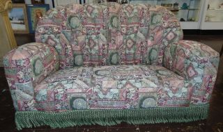 "Vintage Art Deco Upholstered Sofa Vintage Art Deco Upholstered Sofa with Fringe on base. Measures 33"" tall x 60"" wide x 38"" deep. Condition is very good with some minor wear. No damage. Starting Bid $50. Auction Estimate $180 - $250."