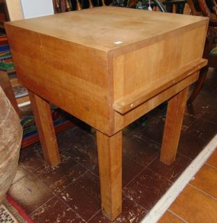 "Solid Wood Butcher Block Table Solid Wood Butcher Block Table. Measures 31"" tall x 24"" wide x 24"" deep. Condition is very good with minimal wear. No damage. Starting Bid $50. Auction Estimate $120 - $150."