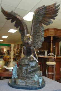 "Life Size Bronze American Bald Eagle Sculpture on Marble Amazing Life Size Bronze American Bald Eagle Sculpture on a Black Marble Base. Very heavy. Aprox 120-150 lbs. Excellent quality and detail with various shades of patina. Bronze may be used indoor or outdoor. He Stands 44"" tall x 35"" wide. Condition is New, Mint. No Damage. This Sculpture is made entirely from Bronze with a Marble Base. Starting Bid $50. Auction Estimate $1000 - $1250."