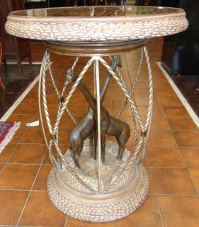 "Unusual Hardwood & Wrought Iron Giraffe Side Table Unusual Hardwood & Wrought Iron Giraffe Side Table. Measures 32-1/2"" tall x 26-1/2"" wide. Condition is very good with minimal wear. No damage. Starting Bid $50. Auction Estimate $250 - $350."