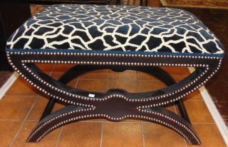 "Animal Print Upholstered Bench Giraffe Print Upholstered Bench Ottoman with decorative Nailheads. Measures 22"" tall x 32"" wide x 18"" deep. Condition is very good with minimal wear. No damage. Starting Bid $50. Auction Estimate $200 - $250."