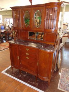 "Antique Inlaid Oak Sideboard Antique Inlaid Oak Sideboard Buffet with Marble Top. Circa 1940's. Original Beveled Glass Doors and Mirror. Display area on top with lots of storage below. Measures 75"" tall x 52"" wide x 19"" deep. Condition is Very good. No Damage. Starting bid $50. Auction Estimate $250 - $300."
