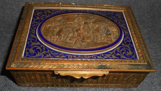 "Antique French Ovington Brothers Gilt Bronze & Enamel Casket Antique French Ovington Brothers of Brooklyn, NY, Gilt Bronze & Enameled Casket or Jewelry Box with Figural Bas Relief. Made in France. Circa 19th Century. High Quality Relief work. Measures 4-1/2"" x 3-1/2""x 1-1/4"" tall. Condition is very good. Wood lined. Starting Bid $50. Auction Estimate $250 - $350."