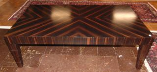 """Contemporary Marquetry Coffee Table Contemporary Marquetry Coffee Table. Measures 54"""" wide x 30"""" deep x 17-1/2"""" tall. Condition is good with some minor wear. Starting Bid $50. Auction Estimate $150 - $250."""
