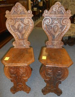 """Pair Antique Italian Carved Walnut Sgabello Hall Chairs Rare Pair of 19th Century Italian Figural Carved Walnut Sgabello Hall Chairs. Circa 1890's. Each stands 39"""" tall. Condition is very good with some wear and scratches typical from age. No Damage. Starting Bid $50 for the pair. Auction Estimate $120 - $150."""