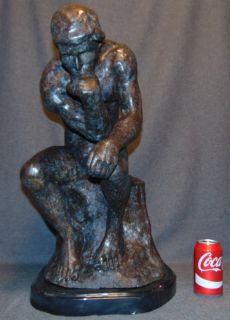 """The Thinker"" Bronze Sculpture Auguste Rodin ""The Thinker"" Bronze Sculpture on a Black Marble Base after Auguste Rodin (1840-1917). Measures 23"" tall x 13"" wide x 19"" deep. Condition is New, Mint. No Damage. This Sculpture is made entirely from Bronze and Marble. Starting Bid $50. Auction Estimate $550 - $650."