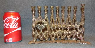 "Vintage Brutalist Brass Hanukkah Menorah by Wainberg Vintage Brutalist Brass Hanukkah Menorah by Israeli Artist Wainberg. Signed Wainberg and Made in Isreal. Circa 1960's. Measures 6-1/2"" tall x 9-1/4"" wide. Condition is very good. No Damage. Starting Bid $30. Auction Estimate $40 - $50."