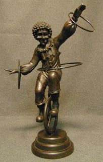 """Bronze Sculpture of a Clown on a Unicycle Bronze Sculpture of a Clown on a Unicycle. He measures 19"""" tall. Condition is very good. No Damage. This Sculpture is made entirely from Bronze. Starting Bid $50. Auction Estimate $150 - $250."""