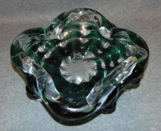 "Murano style Art Glass Cigar Ashtray Bowl Murano style Art Glass Cigar Ashtray or Bowl. Measures 3-1'2"" tall x 9"" wide x 9"" deep. Condition is good with minimal surface wear. No Damage. Starting Bid $40. Auction Estimate $40 - $50."