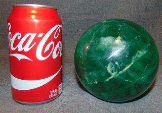 "Natural Green Fluorite Quartz Crystal Ball Natural Green Fluorite Quartz Crystal Ball or Sphere. Aprox 115mm. 4-1/2"" diameter. Condition is Excellent. Mint. Starting Bid $50. Auction Estimate $100 - $150."