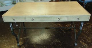 "Faux Ostrich Leather Writing Desk Faux Ostrich Leather Writing Desk with Iron Base. Measures 30"" tall x 56"" wide x 30"" deep. Condition is very good with minimal wear. No damage. Starting Bid $50. Auction Estimate $500 - $600."