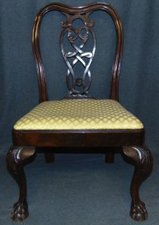"Vintage Childs Size Mahogany Chippendale Side Chair Vintage Reproduction of a Childs Size Mahogany Chippendale Side Chair. Carved Mahogany with Pierced Back Splat and Claw & Ball Feet. Measures 30-1/2"" tall x 19-1/2"" wide x 16"" deep. Condition is good with minimal wear and a minor previous repair (see photo close ups). Starting Bid $50. Auction Estimate $60 - $80."