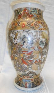 "Japanese Satsuma Vase Vintage Japanese Satsuma Vase. Hand Painted. Hand Decorated with panels of samurai and courtiers on front and back. Measures 11-3/4"" tall. Condition is good. No Damage. Starting Bid $50. Auction Estimate $100 - $120."
