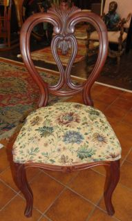 "Antique Carved Mahogany Balloon Back Chair  Beautiful Antique Carved Mahogany Balloon Back Chair. Measures 38"" tall x 18"" wide. Condition is very good with minimal wear. No damage. Starting Bid $50. Auction Estimate $80 - $120."