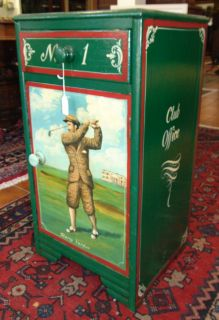 "Golf Theme Hand Painted Table ""Harry Vardon"" Vintage Hand Painted Night Stand or Side Table with a Golf Theme. Homage to ""Harry Vardon"" and famous St.Andrews Scottish Golf Club. Henry William ""Harry"" Vardon was a professional golfer from the Bailiwick of Jersey. He was a member of the Great Triumvirate with John Henry Taylor and James Braid. One Drawer and one Door Table. Measures 28-1/2"" tall x 14-3/4"" wide x 13"" deep. Overall condition is good with minor wear. Starting Bid $50. Auction Estimate $70 - $80."