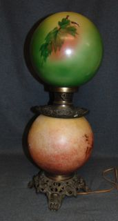 """Vintage Gone With The Wind Table Lamp Vintage Gone With The Wind Table Lamp. Top Globe likely a marriage to base. No chimney. Stands 25-1/2"""" tall. Good to fair Condition. No Damage. Works great. Starting bid $50. Auction Estimate $70 - $80."""