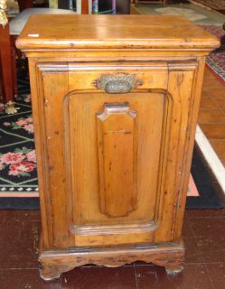 "Antique Pine Coal Box Cabinet or Purdonium  Antique Pine Coal Box Cabinet or Purdonium. Used for Fireside Coal Storage. Measures 29"" tall x 18"" wide x 12-3/4"" deep. Condition is good with minimal wear. No damage. Marked ""J.A & J.L Holliday - Wheeling W Va"". Starting Bid $50. Auction Estimate $60 - $80."