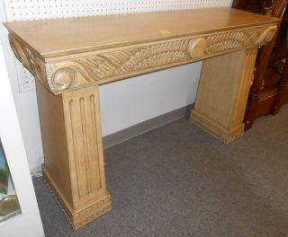 "2 Sided Art Deco Style Console Table 2 Sided Art Deco Style Console Table. Carved on both sides. Stands 35"" tall x 57"" wide x 17"" deep. Condition is very good with minor surface scratches from age. No damage. Starting bid $50. Auction Estimate $80 - $100."