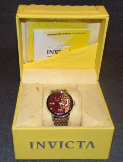 """Mens Invicta Chinese Legend Series """"Tiger"""" Gemstone Watch NEW Mens Invicta Chinese Legend Series """"Tiger"""" Stainless Steel Gemstone Wrist Watch. Model #5129. Brand New in the Original Box. Swiss SW200 Automatic movement. Sapphire Crystal. Original Invicta burgundy dial with raised rose gold tone markers. Right side of the dial features an exotic tiger made from black diamond and orange sapphire stripes, green tsavorite eyes, white MOP (mother of pearl) ears, and red lacquer nose and tongue. Invicta stainless steel bracelet with Invicta signed deployment clasp. Includes Yellow Invicta Box. Condition is New, Mint. Never Worn. No Damage. $5000 Retail Price. Starting Bid $50. Auction Estimate $1000 - $1500."""