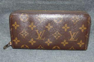 """Vintage Louis Vuitton Monogram Zip Around Wallet Genuine & RARE Vintage Louis Vuitton Monogram Zipper Around Wallet. Authentic Louis Vuitton. Measures 7-3/4"""" x 4"""". Condition is very good with minimal wear. No damage. Starting Bid $50. Auction Estimate $150 - $300."""