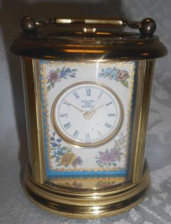"Halcyon Days Enameled Miniature Carriage Clock Halcyon Days Enameled Miniature Carriage Clock. 8 Day Carriage Clock With Gilded Brass Case And Enamel Panel. Measures 2-1/2"" tall. Condition is very good with some minor losses to brass finish. Starting bid $50. Auction Estimate $120 - $150."