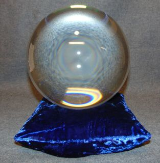 """200mm Clear Crystal Ball on Blue Velvet Pillow Beautiful Clear 200mm Crystal Ball on Blue Velvet bean Pillow. Aprox 200mm. 8"""" diameter. Condition is Excellent. Mint. Starting Bid $50. Auction Estimate $100 - $120."""