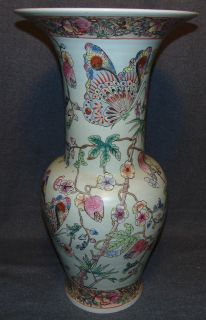 "Vintage Hand Painted Oriental Floor Vase Vintage Hand Painted Oriental Floor Vase. Large, Trumpet form. Decorated with Butterflies. Measures 24-1/4"" tall x 13"" wide. Condition is good with minimal wear. No damage at all. Heavy and thick. Aprox 25-30lbs. Starting Bid $30. Auction Estimate $30 - $40."