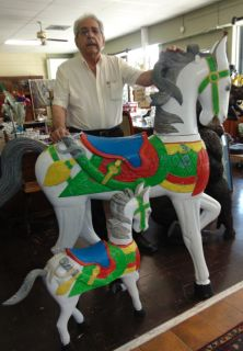 """Large Carved and Painted Reproduction Carousel Horse  Large Carved Wood and Hand Painted Reproduction Carousel Style Horse. Measures 59-1/2"""" tall x 61"""" wide. Overall condition is very good with minor losses to Paint. Also, crack in tail as well as a minor chip in saddle (see close-ups). Starting Bid $50. Auction Estimate $200 - $300."""