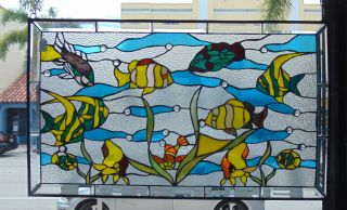 "Custom Stained Glass Hanging Panel Custom Stained Glass Hanging Panel with Fish. Measures 23-1/4"" tall x 39"" wide. Condition is New, Mint. No Damage. Starting Bid $50. Auction Estimate $100 - $150."