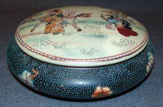 "Japanese Satsuma Lidded Jar Japanese Satsuma Lidded Jar. Hand Painted & Signed. Measures 3-1/2"" tall x 11"" wide. Condition is very good. No Damage. Starting Bid $50. Auction Estimate $50 - $60."
