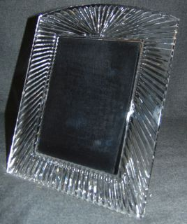 "Waterford Crystal Somerset 5"" x 7"" Picture Frame MINT Large Waterford Crystal 5"" x 7"" Picture Frame. In the ""Somerset"" pattern. Frame measures 10-1/2"" tall x 8-1/2"" wide. Condition is very good. No damage at all. Starting Bid $30. Auction Estimate $30 - $40."