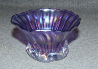 "John Gilvey Studio Amethyst Glass Bowl 1994 Lovely John Gilvey Studio Pulled Feather Amethyst Glass Bowl. Iridescent Amethyst with Clear Glass Base. Measures 2-3/4"" tall x 4-1/4"" wide. Artist signed and dated 1994. Condition is very good. No Damage. Gilvey Glass Studio started up their furnace in 1980 in the Hudson Valley after a one year apprenticeship with glass artist Steven Fellerman and a brief studio at the Webatuck Craft Village. John Gilvey's business grew substantially during the 1980's producing perfume bottles, vases and paperweights for exclusive department stores such as Bergdorf Goodman, I Magnum, Harrods of London and Nieman Marcus. Starting Bid $40. Auction Estimate $40 - $50."
