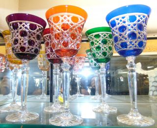 "6 Multi-Color Bohemian Cut Crystal Wine Glasses Beautiful Set of 6 Multi-Color Bohemian Cut to Clear Crystal Wine Glasses. Heavy and high quality European Leaded Crystal. Each measures "" tall. Condition is New, Mint. No Damage. Includes Fitted and lined Gift Box. Starting Bid $50 for all 6. Auction Estimate $200 - $250."