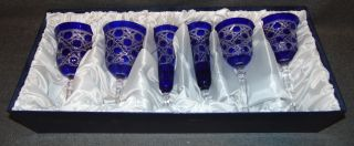 "6 Cobalt Blue Cut to Clear Crystal Glasses 6 Cobalt Blue Cut to Clear Crystal Glasses. 2 Wine, 2 Champagne and 2 Water. Heavy and high quality European Leaded Crystal. Wine & Champagne glasses measure 9"" tall each. Water is 7-3/4"". Condition is New, Mint. No Damage. Includes Fitted and lined Gift Box. Starting Bid $50. Auction Estimate $200 - $250."