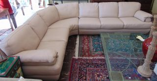 Natuzzi Leather Sectional with Corner Wedge Natuzzi Beige Leather Sectional with Corner Wedge. Not a recliner. Overall condition is good. Starting Bid $50. Auction Estimate $700 - $1000.