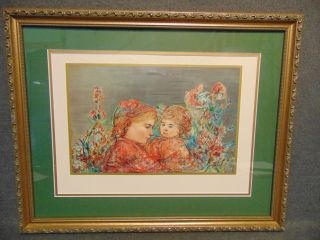 """Edna Hibel (1917-2014) Framed and Matted Print Edna Hibel (1917-2014) Framed and Matted Print. Edna Hibel, a painter of sentimental pictures of children, has had a more than 60-year career as painter and lithographer and promoter of peace through exhibitions of her artwork. Hibel's work has been exhibited in museums and galleries in more than 20 countries including Russia, Brazil, China, Costa Rica, and the United States, and under the royal patronage of Count and Countess Bernadotte of Germany, Count Thor Bonde of Sweden, Prince and the late Princess Rainier of Monaco and Her Majesty Queen Elizabeth II of England. Frame measures 18-1/2"""" tall x 23-1/4"""" wide. Condition is very good with minimal wear. No damage. Starting Bid $30. Auction Estimate $30 - $40."""