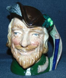 "Royal Doulton Toby Mug Robin Hood #6527 Large Royal Doulton Toby Mug ""Robin Hood"" #6527. Measures 7-1/2"" tall. Condition is very good. Excellent. No Damage. Starting Bid $30. Auction Estimate $30 - $40."