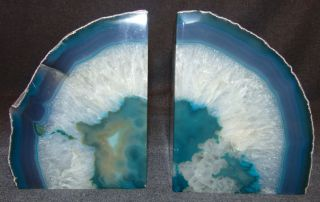"Large Brazilian Dyed Blue Green Agate Bookends Pair (2) of Large Brazilian Gem Polished Dyed Blue Green Agate Bookends. Each stands 6-1/4"" tall. Condition is Mint. No Damage. Starting Bid $50. Auction Estimate $80 - $100."