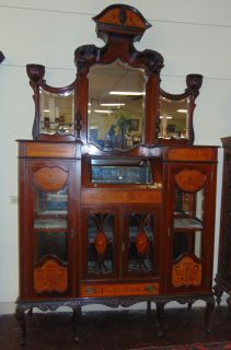 "Antique English Inlaid Mahogany Etagere Cabinet Large Antique English Inlaid Mahogany Etagere Cabinet. Measures 104"" tall (8' 8"") x 60"" wide x 18-1/2"" deep. Condition is good to fair with wear and scratches typical from age and use. Velvet fabric in display areas is tattered. Still a beautiful piece. Starting Bid $50. Auction Estimate $350 - $500."